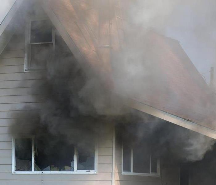 Smoke from a house fire.