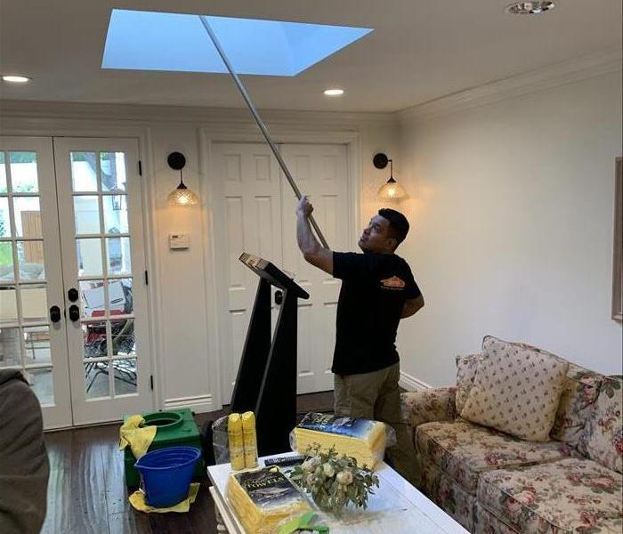 A SERVPRO specialist cleaning soot from a fire.